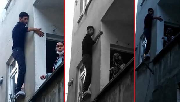 Hırsızlık için girdi, bina sakinlerine yalvardı! Camda asılı kaldı